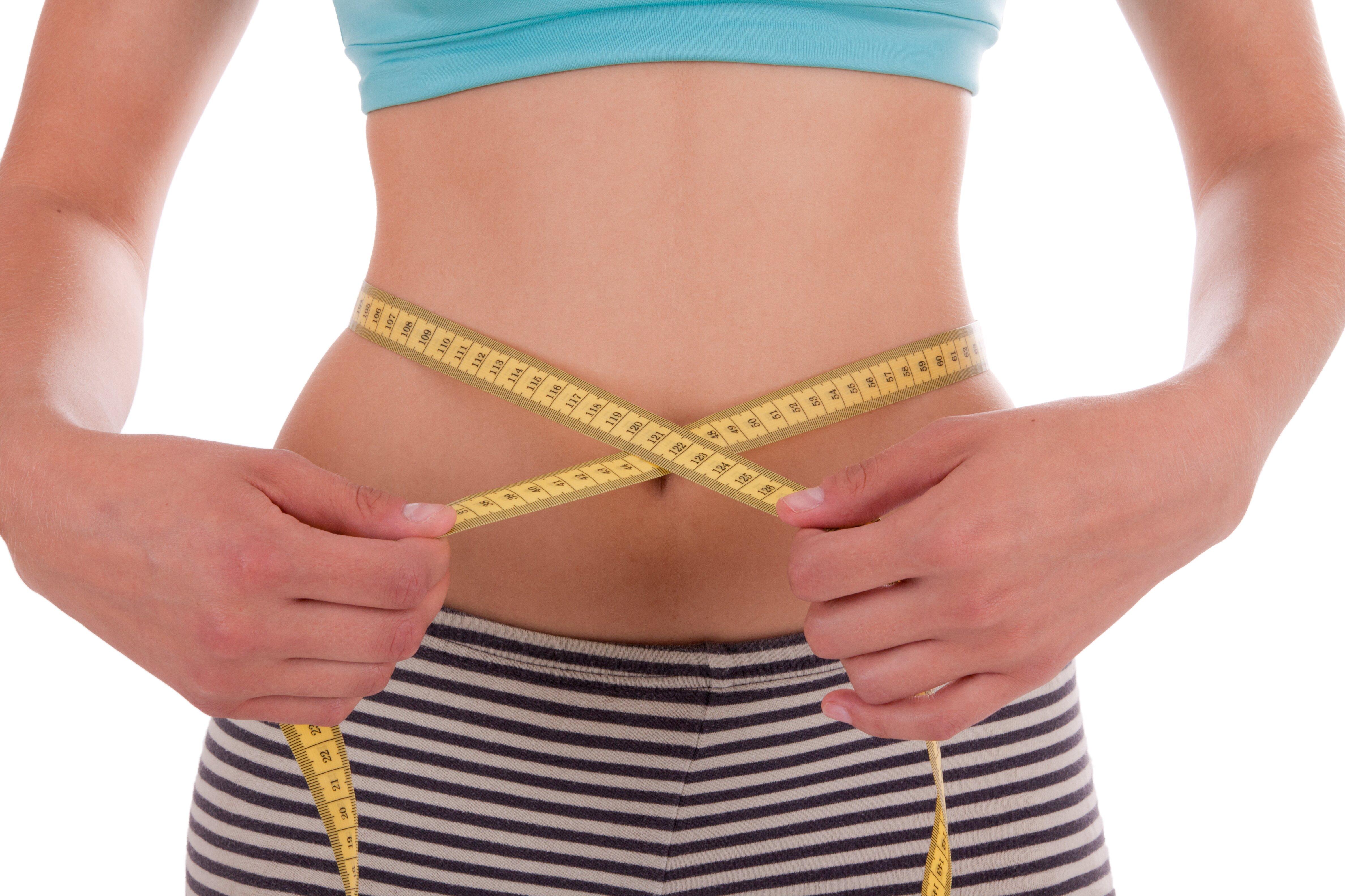 Girl measuring her hips