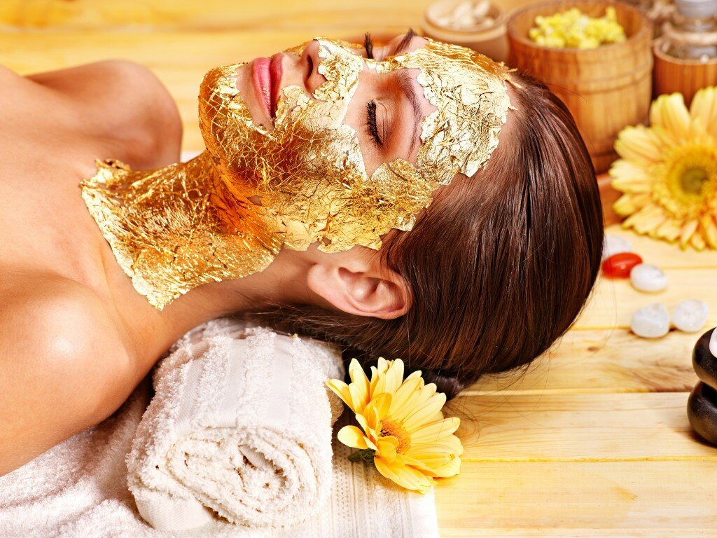 Woman Getting A Gold Facial