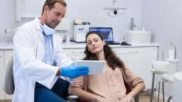 Dentist explaining to a patient