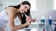 a woman brushing her teeth